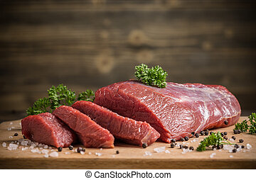 Beef meat - Fresh raw beef meat slices on wooden board