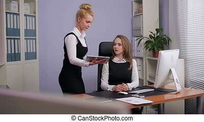 Business Woman Using a Tablet PC to - Manager accesses the...