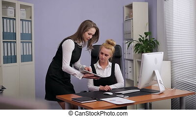 Business Woman Using a Tablet PC to
