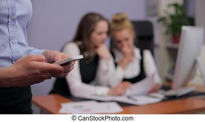 Businesswoman Sending Message - Businesswoman sending a...