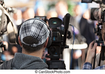 News conference - Filming an event with a video camera