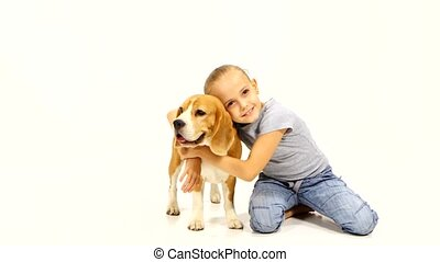 little girl hugging Beagle puppy - little girl hugging...