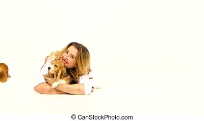 woman with cute beagle puppy on the floor in studio