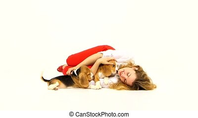 woman with cute beagle puppy on a white background woman...