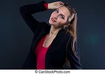 Image of smiling woman taking off glasses