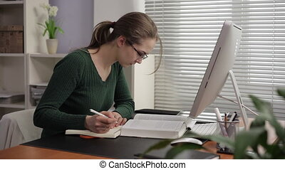 Teacher prepares a lecture - The teacher writes the...
