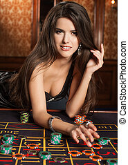 Beautiful brunette plays in casino. photo - brunette girl in...