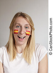 Happy Spanish sports fan - Happy female sports fan with face...