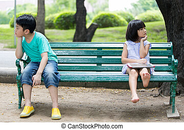 Conflict between the Asian brother and sister sitting on a...