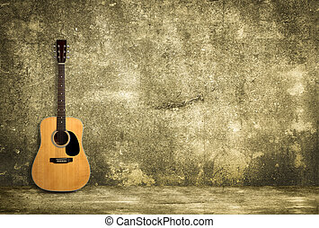 Acoustic guitar against old wall - Acoustic guitar is...