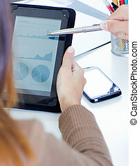 executive hands with digital tablet in a financial meeting -...