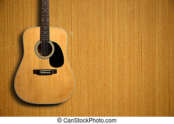 Acoustic guitar on wooden background - Acoustic guitar is on...