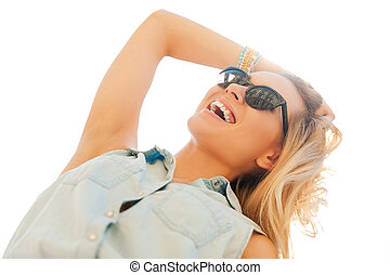 Enjoying sunshine. Low angle view of cheerful young woman...