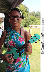 Polynesian Festival - Young woman with colorful ukulele at...