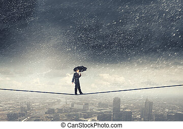 Pessimist in business - Walking on rope businessman with...