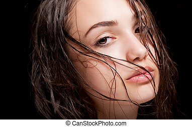 Wet hair beauty. - Portrait of gorgeous young brunette woman...