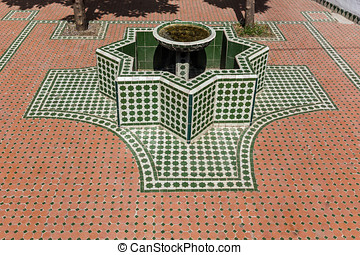 Moroccan fountain - Fountain shaped eight-pointed star in...