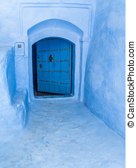 The blue gate - Door in the blue medina of Chefchaouen,...