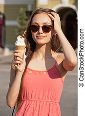 Summer ice cream fun. - Gorgeous young brunette woman having...