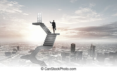 Way to success - Businesswoman walking up staircase to door...