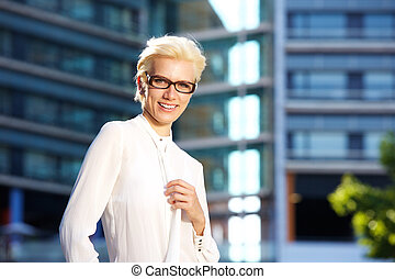 Confident woman smiling with glasses - Portrait of a...