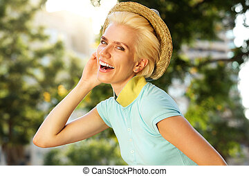 happy smiling young woman with hat