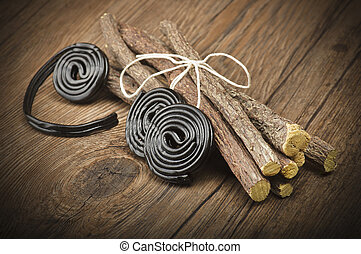 Licorice wheels candies close up on the wood