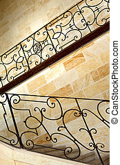 Upstairs - Wrought iron handrail and upstairs in a French...