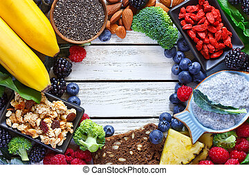 Superfood. Frame of healthy vegan ingredients on white...