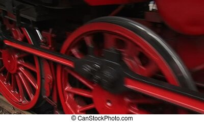 Steam locomotive close up red wheels turning + stops - full...