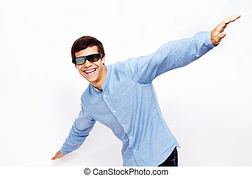 Guy flying in 3D glasses - Young hispanic man wearing jeans...