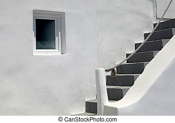 Detail of greek house with steps and window, Santorini -...