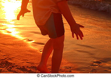 Evening play on the Baltic - A small child is running on the...