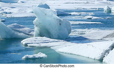 Ice blocks break down at the glacier lagoon Jokulsarlon in...