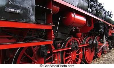 Steam locomotive close up red wheels + departs - full screen...