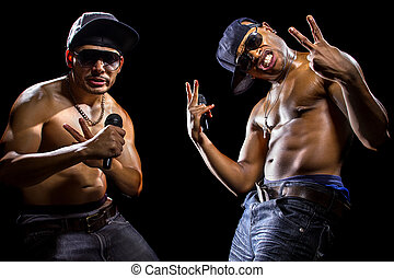 Rappers with Microphones - Rap concert with two muscular...
