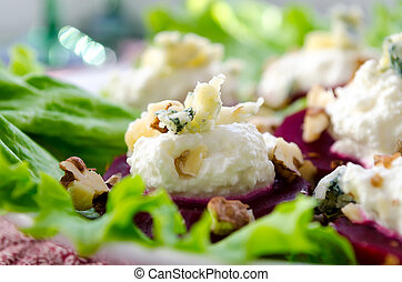 Beet Salad with goat cheese, walnuts, greens and herbs and...