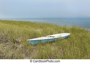Small Sailboat Sitting in Dune Grass Next to Lake Huron -...