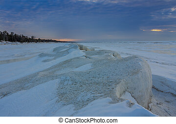 Natural Ice Sculptures on a Frozen Lake Huron at Sunset -...