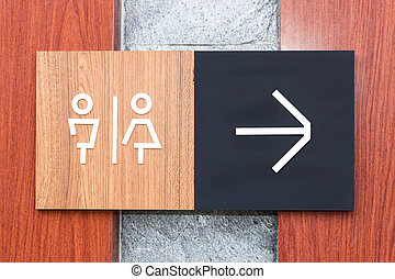 Unisex restroom or toilet and arrow sign on wall style...