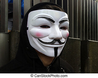 Anonymous group member wearing Guy Fawkes mask - AUCKLAND,...