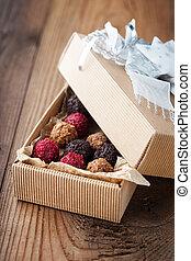 Chocolate truffles - Assorted dark chocolate truffles with...