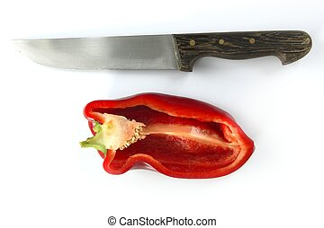 Red pepper and kitchen knife over white
