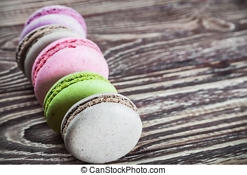 macaroon on a wooden table. focus on the foreground macaroon