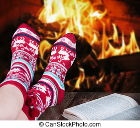 Christmas female legs in socks on the background of a...