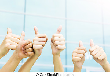 Group of hands with thumbs up expressing positivity