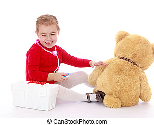Little girl Teddy bear treats - Smiling little girl in a red...