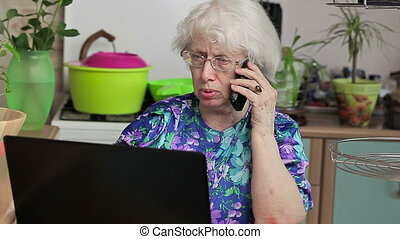 Elderly lady with cell phone near