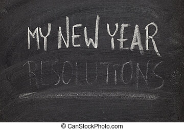 forgetting new year resolutions - concept on blackboard -...