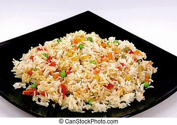 Fried rice with vegetables on a white background